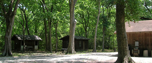 Wooden cabins in the woods at Camp Wind-A-Mere near Alvin, Texas