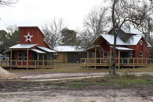 Bird house style cabins along a lakefront at Camp Pryor in Nada
